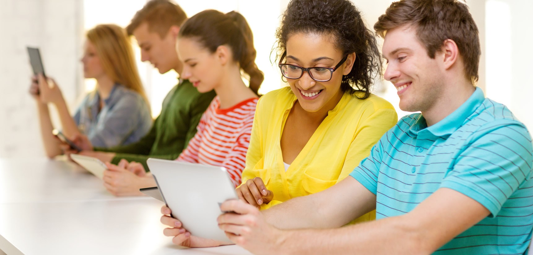 smiling-students-looking-at-tablet-pc-at-school-m-1721